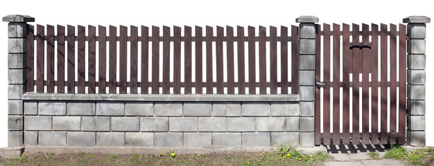 Rural simple fence from brown vertical wooden boards