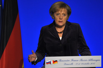 German Chancellor Merkel speaks at a news conference in Deauville