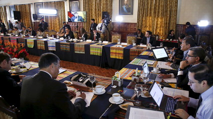 Ecuador's President Rafael Correa addresses foreign media at Carondelet Palace in Quito