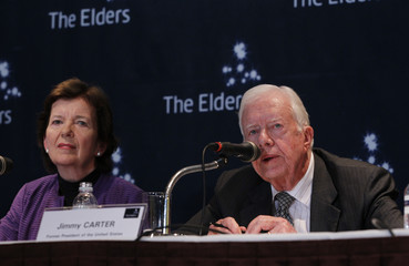 Former U.S. President Carter and former Irish President Robinson speak during a news conference in Seoul