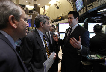 Huntington Ingalls Industry CEO Mike Petters speaks with specialist trader James Balducci as he tours the floor of the New York Stock Exchange in New York