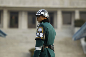 A South Korean soldier stands guard as he faces the North Korea side at the border village of Panmunjom