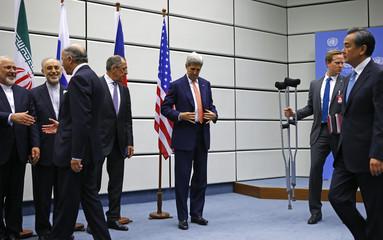 U.S. Secretary of State Kerry prepares for a family photo next to Iranian FM Zarif, Iranian ambassador to IAEA Salehi, French FM Fabius, Russian FM Lavrov and Chinese FM Wang Yi in Vienna