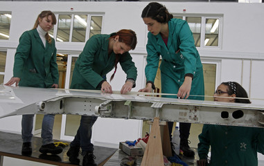 Pupils work on the wing of a plane at a classroom of aeronautics in the Instituto do Emprego e Formacao Profissional (IEFP) vocational training center in Setubal