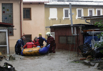 Firefighters evacuate residents from their flooded house in Chrastava