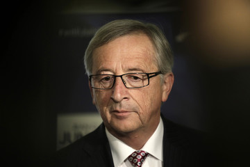 Former Luxembourg's Prime Minister and European Commission President candidate Jean-Claude Juncker listens to the media before a panel discussion on European affairs in Riga