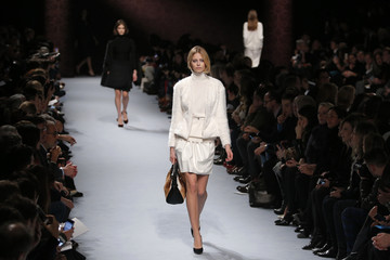 Models present creations by British designer Peter Copping as part of his Fall/Winter 2014-2015 women's ready-to-wear collection for fashion house Nina Ricci during Paris Fashion Week
