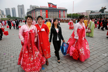 Participants leave the capital's main ceremonial square after a mass rally and parade, a day after the ruling party wrapped up its first congress in 36 years by elevating him to party chairman, in Pyongyang