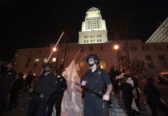 Los Angeles police officers stand guard as they evict protesters from the Occupy LA encampment outside City Hall in Los Angeles
