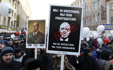Protestors hold placards during a demonstration for fair elections in St.Petersburg