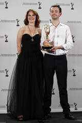 "Actress Wilson  and BBC drama commissioner Stephenson pose with their award for Best TV Movie/Mini-Series for ""Small Island"" at the 38th International Emmy Awards in New York City"