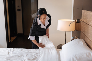 Nice serious woman working in the hotel