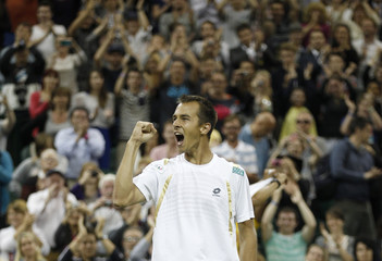 Lukas Rosol of the Czech Republic celebrates after defeating Rafael Nadal of Spain in their men's singles tennis match at the Wimbledon tennis championships in London