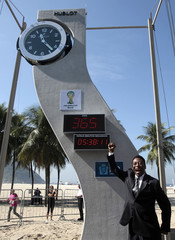 Brazilian soccer icon Pele gestures in front of the countdown clock during an event marking one year to the kick-off of the 2014 FIFA World Cup at Copacabana beach in Rio de Janeiro