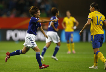 Kawasumi of Japan celebrates after scoring against Sweden during their Women's World Cup semi-final soccer match in Frankfurt