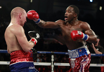 Boxer Adrien Broner from Cincinnati, Ohio connects to the head of Gavin Rees from Newport, Wales during their WBC Lightweight title bout in Atlantic City
