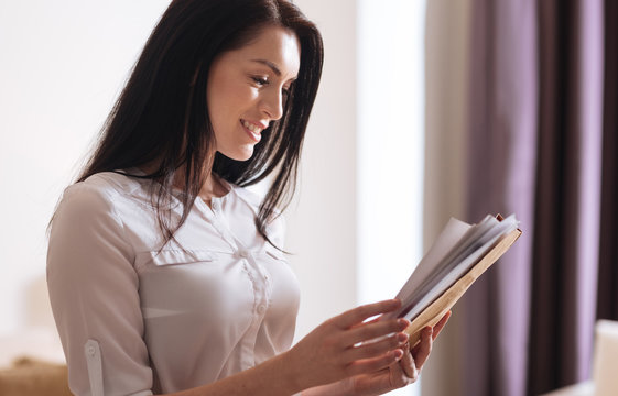 Happy delighted businesswoman looking at her mail