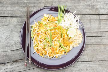 Thai food Pad thai , Thai style noodles on wood background.