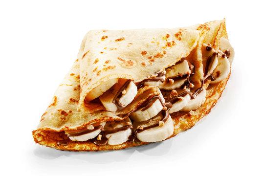 Banana pancake crepes with chocolate and nuts