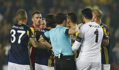 Referee Milorad Mazic seperates players as they clash