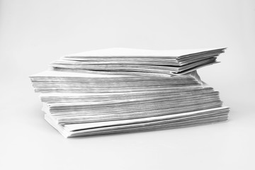 Uneven pile of post envelopes on a table