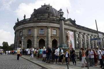 People queue at ticket counters and main entrance to the Bode museum in Berlin