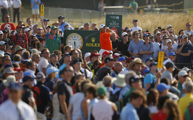 Spectators surround Lee Westwood of England during the third round of the British Open golf championship at Muirfield in Scotland