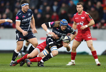Magnus Lund of Sale Sharks is tackled by