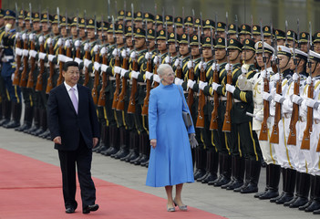 Denmark's Queen Margrethe II and China's President Xi Jinping inspect honour guards in Beijing