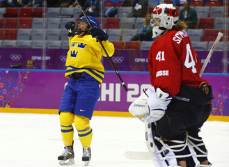 Sweden's Uden Johansson celebrates her goal on Switzerland's goalie Schelling during the second period of their women's ice hockey bronze medal game at the Sochi 2014 Winter Olympic Games