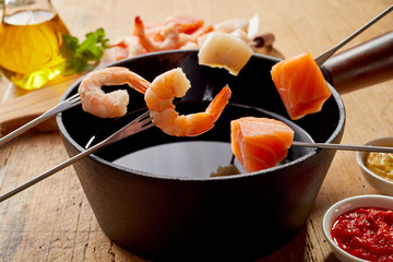 Pink prawns and fresh salmon in a seafood fondue