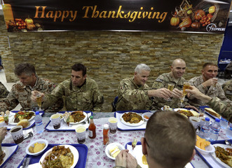U.S. troops eat during a Thanksgiving meal at a NATO base in Kabul