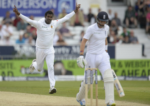 Sri Lanka's Mathews celebrates as England's Root leaves the field after being dismissed during the second cricket test match at Headingley cricket ground in Leeds, England
