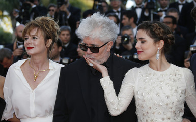 """Director Pedro Almodovar, cast members Michelle Jenner and Emma Suarez pose on red carpet as they arrive for the screening of the film """"Julieta"""" in competition at the 69th Cannes Film Festival in Cannes"""