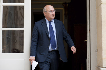 France's Labour, Employment and Social Dialogue Minister Sapin leaves after a meeting with France's Prime Minister and union representatives at the Hotel Matignon in Paris