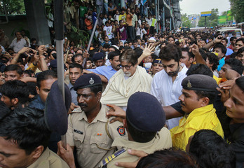 Bollywood actors Amitabh and his son Abhishek arrive to attend the funeral of actor Rajesh Khanna in Mumbai