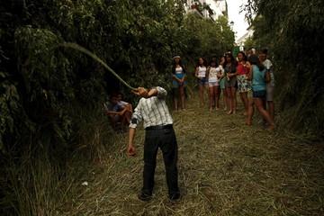 "A boy plays with a ""cachiporra"" during Corpus Christi day in Zahara de la Sierra"