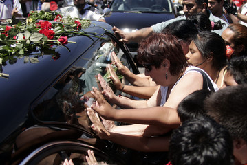 People approach the hearse carrying the coffin of Argentine pop singer Sandro to bid farewell in Buenos Aires