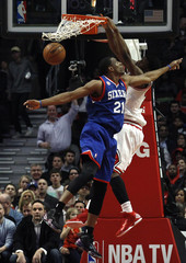 Chicago Bulls' Jimmy Butler dunks the ball over Philadelphia 76ers' Thaddeus Young during their NBA game in Illinois