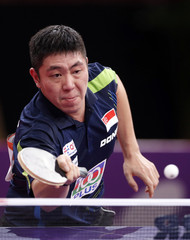 Gao Ning of Singapore returns a shot to Chen Chien-An of Taiwan in their men's singles third round match at the World Team Table Tennis Championships in Paris