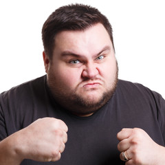 Angry man fighting with clenched fists, isolated