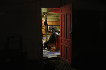 Nicolas Vargas Saavedra sits at his home as he waits for his family's eviction and the demolition of their house in Madrid