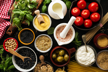 Food background Food Concept with Various Tasty Fresh Ingredients for Cooking. Italian Food Ingredients. View from Above.