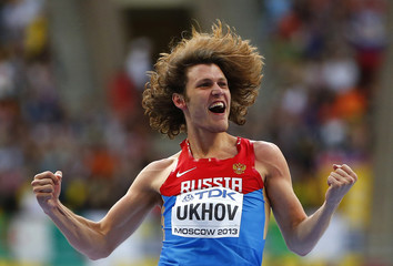 Ukhov of Russia reacts after competing in the men's high jump final during the IAAF World Athletics Championships at the Luzhniki stadium in Moscow