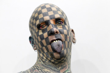 """Matt Gone, also known as """"The Checkered Man"""", poses during the """"Expo Tatuaje"""" international, a tattoo expo, in Monterrey"""