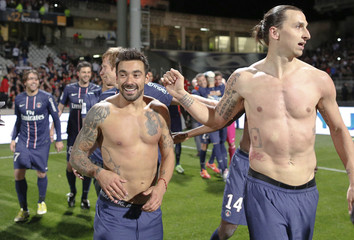 Paris Saint-Germain's Ibrahimovic and Lavezzi celebrate at the end of their team's French Ligue 1 soccer match against Olympique Lyon at the Gerland stadium in Lyon