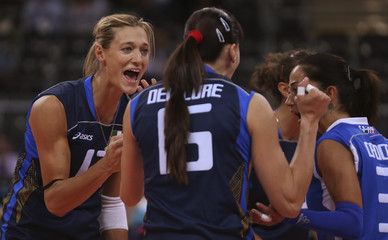 Italy's Simona Gioli, Antonella del Core and Paola Croce celebrate a point against Japan during their women's Group A volleyball match at the London 2012 Olympic Games at Earls Court