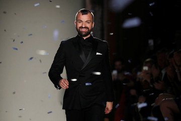 French designer Julien Fournie appears at the end of his Haute Couture Fall Winter 2016/2017 fashion show in Paris