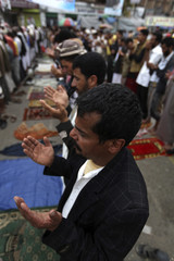 Anti-government protesters pray during at the Taghyeer (Change) Square, where the protesters have been camping for more than a year to demand regime change, in Sanaa