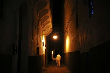 A man leaves a mosque after evening prayers in Medina, Rabat's old city